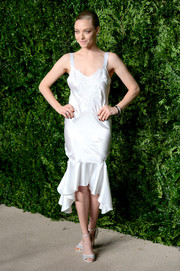 Amanda Seyfried complemented her dress with white ankle-strap peep-toe heels, also by Givenchy.