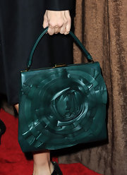 Actress Roma Maffia was spotted at the Costume Designers Awards rockin' a sweet teal Valentino bag. A nice substitute for a fall look.