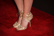 Liz Goldwyn showed off her gold lace heels while posing on the red carpet. The ankle lace up heels were all-too-stylish and were almost as glamourous as her.