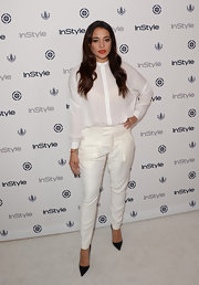Natalie made a statement in white when she sported a classic button down with a pair of tapered trousers.