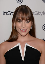 Christa kept her look streamline and contemporary with a sleek and shiny straight hairstyle.