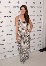 Katie went for cool geometric shapes with this black-and-white maxi dress, which she wore at InStyle Summer Soiree.