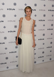 Isabel opted for a soft and romantic look when she wore this flowing lace gown to InStyle's Summer Soiree.