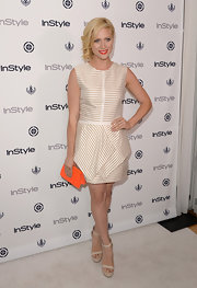 Brittany kept it sophisticated and preppy with a nude-and-white striped dress.