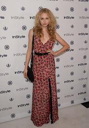 Penelope Mitchell chose this red floral maxi dress to add a touch of boho style to her look at the InStyle Summer Soiree.