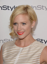 Brittany pinned her curls to the side for a soft and romantic red carpet look.