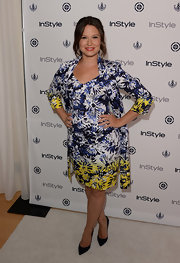 Katie got bold with graphics when she wore this blue, white, and yellow abstract floral frock and matching jacket.