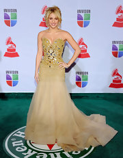 Shakira looked flawless at the Latin Grammys in a golden evening gown with a beaded bodice.