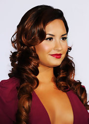 Demi Lovato showed off her glorious tresses by wearing her hair in long spiral curls at the 12th Annual Latin GRAMMY Awards.