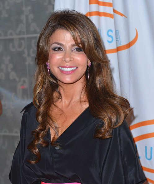 Paula Abdul arrived for the 12th Annual Lupus LA Orange Ball wearing her long polished curls in subtle layers.