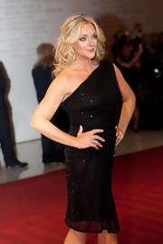 Jane sparkles in a black one shoulder dress.