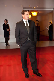 Steve Carrell looked suave in a black pinstriped suit.
