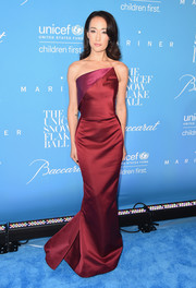 Maggie Q was sleek and stylish in a strapless burgundy gown by Zac Posen at the UNICEF Snowflake Ball.