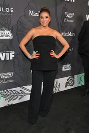 Eva Longoria matched her top with black slacks.