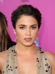 Nikki Reed accented her twisted updo with decorative gold hoop earrings.