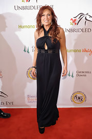 Jo Dee Messina looked foxy on the Kentucky Derby red carpet in a black halter gown with peekaboo detailing.