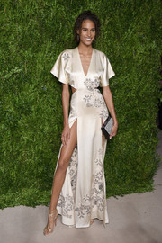 Cindy Bruna polished off her sophisticated look with gold T-strap sandals by Christian Louboutin.