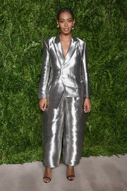 Solange Knowles went futuristic in a silver wide-leg pantsuit for the CFDA/Vogue Fashion Fund Awards.