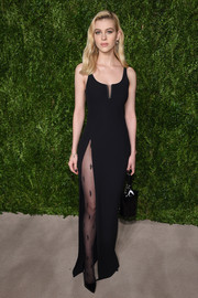 Nicola Peltz cut a sultry figure at the CFDA/Vogue Fashion Fund Awards in a body-con black Alexander Wang gown with a hip-high slit.
