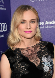 Diane Kruger amped up the sweet vibe with a bright pink lip.