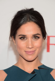 Meghan Markle went for a low-key beauty look with some pale pink lipstick.