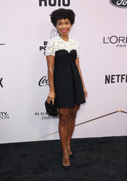 Logan Browning kept it girly in a black Valentino dress with a contrast lace yoke at the 2020 Essence Black Women in Hollywood Awards.