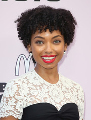 Logan Browning wore her hair in short, tight curls at the 2020 Essence Black Women in Hollywood Awards.