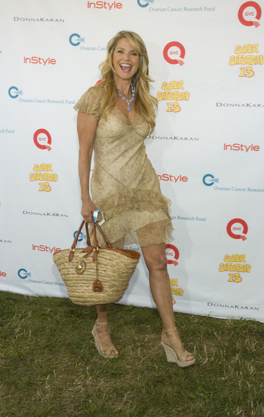 Christie paired her wedge heels with a woven tote bag.