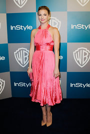 Emily VanCamp paired her bright pink halter dress with nude patent leather pumps.