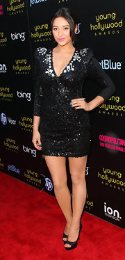 Just in case the party was a bust, 'Pretty Little Liar' Shay Mitchell brought the fun with her with her fully sequined black mini dress. The frock featured strong shoulders, a deep v-neck and enough beads that she could shimmy and shake all night long!