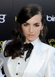 Camilla Belle accented her tailored look with black gemstone earrings.