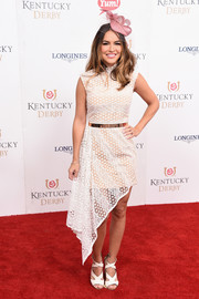 Chrishell Stause complemented her frock with white cross-strap sandals.