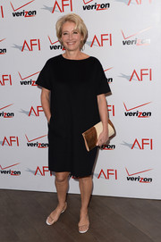 Emma Thompson styled her simple dress with a Cambria Handmade metallic-panel clutch.