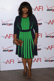 Octavia Spencer infused a classic element into her look with a pair of leopard-print peep-toes and a matching clutch.