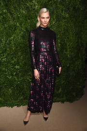 Karlie Kloss slipped into a purple and black sequin jumpsuit by Dior for the CFDA/Vogue Fashion Fund Awards.