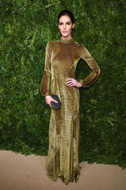 Hilary Rhoda polished off her look with a geometric box clutch.