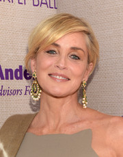 Sharon Stone dolled up her simple hairstyle with an eye-catching pair of pearl and gemstone chandelier earrings.