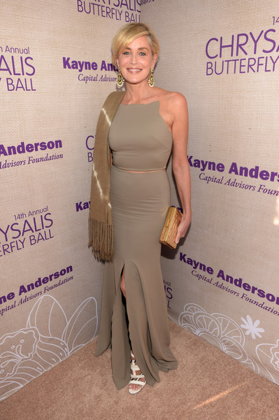 Sharon Stone flaunted her ageless figure at the Chrysalis Butterfly Ball in a tight-fitting gray gown with a slashed midsection that made it look like a two-piece.