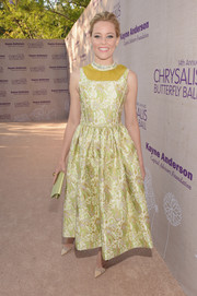 Elizabeth Banks made a vibrantly elegant choice with this chartreuse jacquard cocktail dress by Prada for the Chrysalis Butterfly Ball.