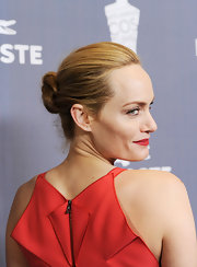 Amber Valletta attended the 14th Annual Costume Designers Guild Awards wearing her hair swept back into a classic bun.