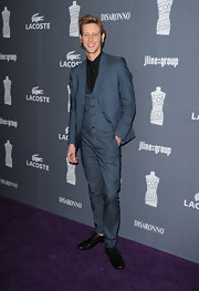 Gabriel Mann arrived at the Costume Designers Guild Awards in a sleek three-piece suit.