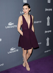 Rooney Mara wore this plum cocktail dress with a sexy plunge and sweet pockets to the Costume Designers Guild Awards.