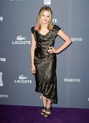 Chloe added spice to her cocktail frock with snakeskin strappy sandals.