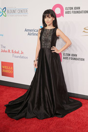 Hilaria Baldwin went for goth glamour in a floor-sweeping black gown with an embellished bodice during the Enduring Vision benefit.