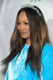 Garcelle Beauvais looked gorgeous with her boho 'do, complete with a beaded headband, at the Global Green pre-Oscar party.