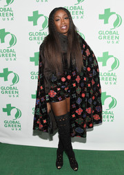 Estelle hit the Global Green pre-Oscar party wearing a patterned cape and matching shorts.