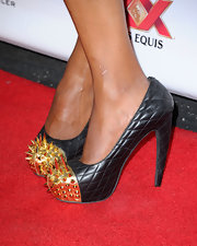 Aisha Tyler added a little edge to her red carpet look with these black quilted heels that featured a gold spiked toe.
