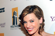 Milla Jovovich Wears a Canary Red Evening Dress