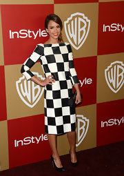 Jessica Alba paired her checkered dress with black patent leather Casadei pumps.