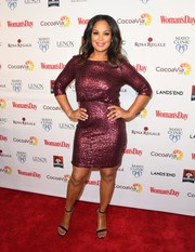 Laila Ali sparkled on the red carpet in a purple sequined frock during the Woman's Day Red Dress Awards.